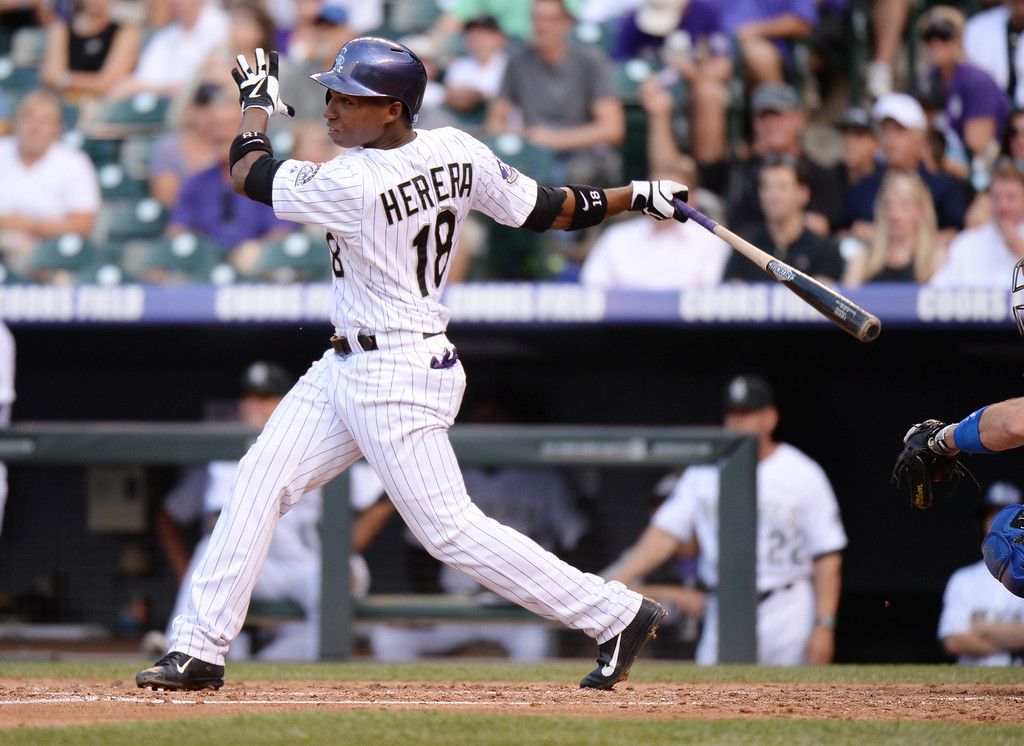 . DENVER, CO. - July 03: Jonathan Herrera of Colorado Rockies (18) doubles from Zack Greinke of Los Angeles Dodgers (21) in the 1st inning of the game at Coors Field. Denver, Colorado. July 3, 2013. (Photo By Hyoung Chang/The Denver Post)