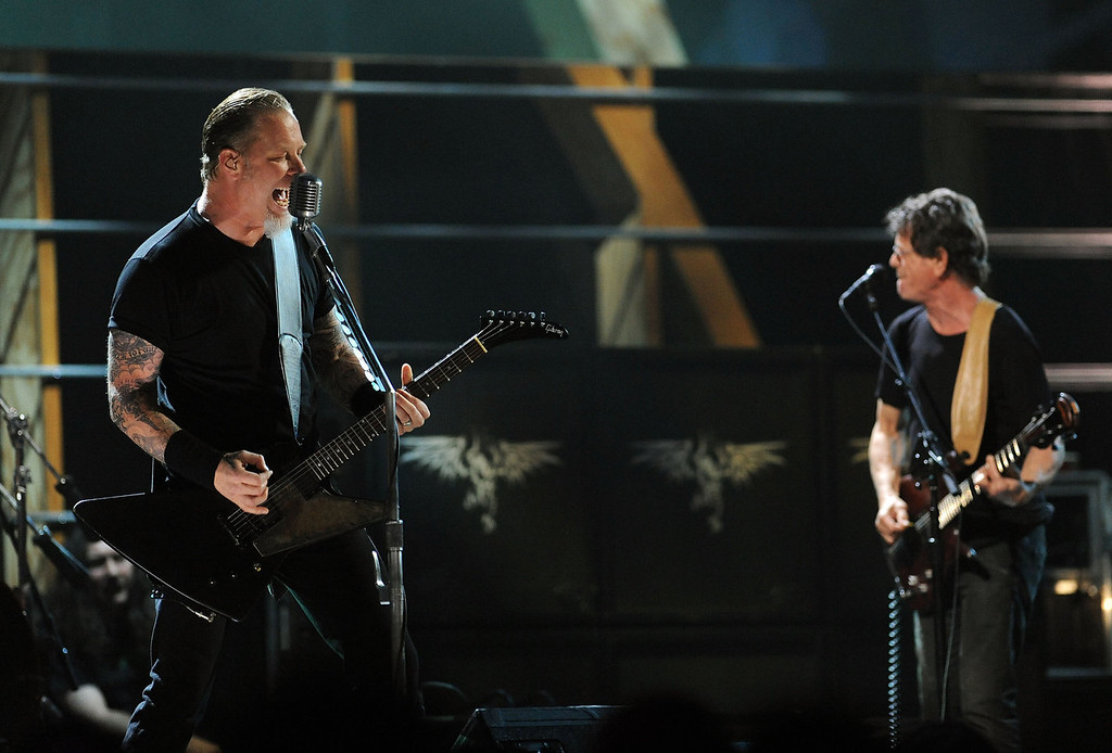 . James Hetfield of Metallica performs with Lou Reed onstage at the 25th Anniversary Rock & Roll Hall of Fame Concert at Madison Square Garden on October 30, 2009 in New York City.  (Photo by Stephen Lovekin/Getty Images)