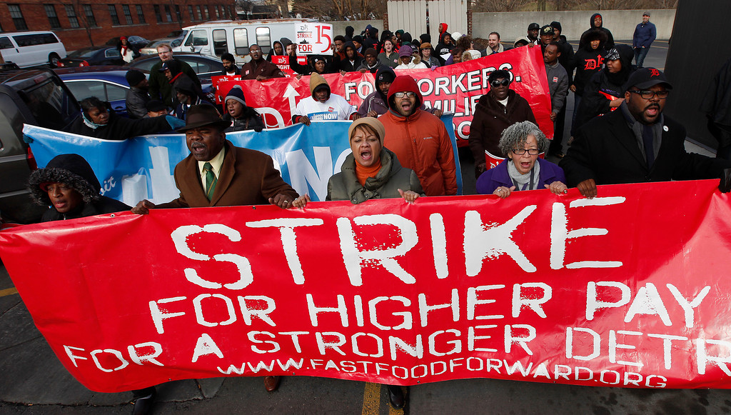 . Protesters rally for better wages at a Wendy\'s in Detroit Thursday, Dec. 5, 2013.  (AP Photo/Paul Sancya)