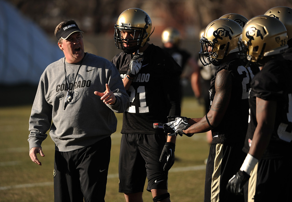. BOULDER, CO- MARCH 7 :  Head coach Mike MacIntyre talks to players during practice. The Colorado Buffaloes football team hit the practice field for the first time this season with new head coach Mike MacIntyre in Boulder, CO on March 7, 2013. (Photo By Helen H. Richardson/ The Denver Post)