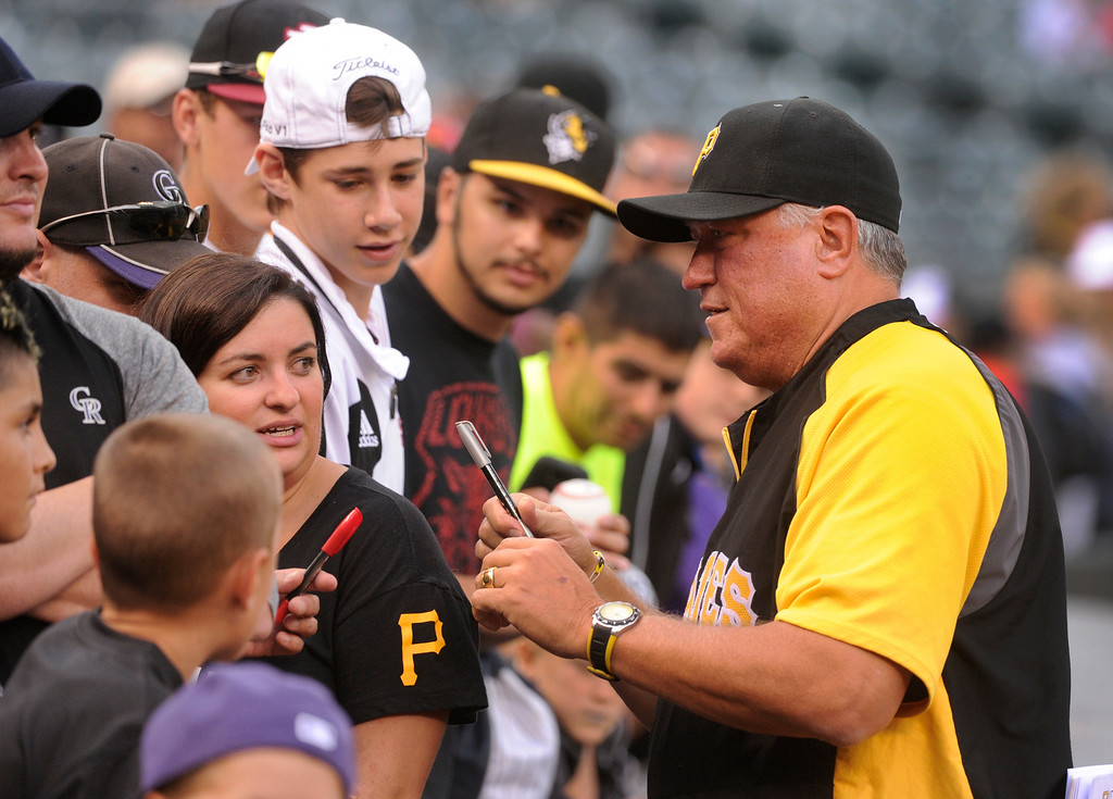. DENVER, CO. - AUGUST 09: Pirates manager Clint Hurdle chatted with fans as he signed autographs before the game Friday night. The Colorado Rockies hosted the Pittsburgh Pirates Friday night, August 9, 2013. Photo By Karl Gehring/The Denver Post