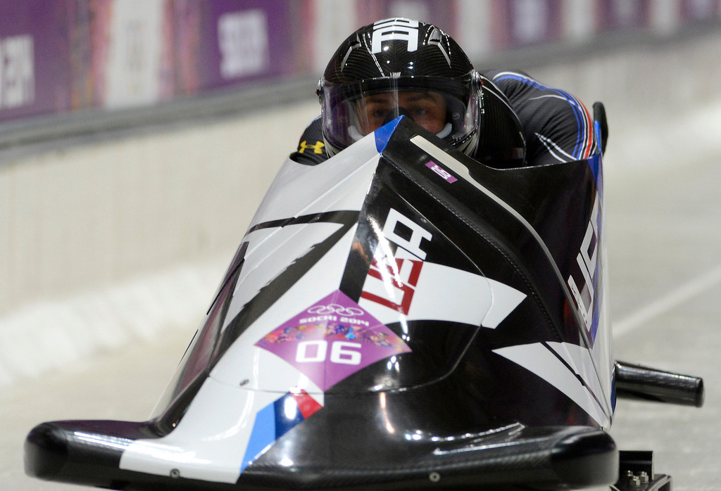 . USA bobsled driver Nick Cunningham, front, of Monterey, competes in the Two-man Bobsleigh at the Sanki Sliding Center for the 2014 Winter Olympics in Krasnaya Polyana, Russia, on Sunday, Feb. 16, 2014.  (Nhat V. Meyer/Bay Area News Group)