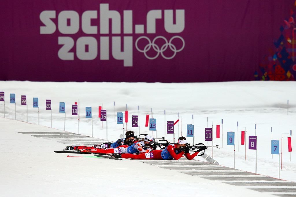 . Scott Perras of Canada, Krzysztof Plywaczyk of Poland and Simon Hallenbarter of Switzerland compete in the 2 x 6 km Women + 2 x 7 km Men Mixed Relay during day 12 of the Sochi 2014 Winter Olympics at Laura Cross-country Ski & Biathlon Center on February 19, 2014 in Sochi, Russia.  (Photo by Julian Finney/Getty Images)