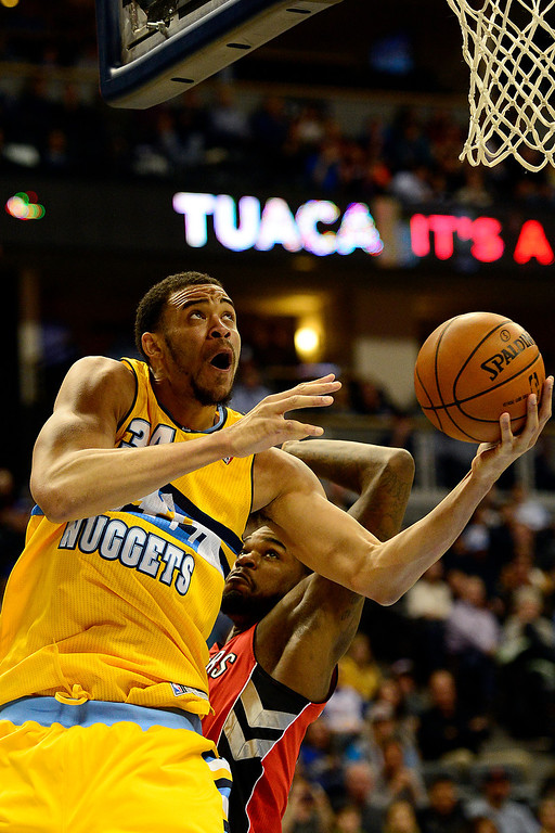 . Denver Nuggets center JaVale McGee (34) scores against the Toronto Raptors during the first half at the Pepsi Center on Monday, December 3, 2012. AAron Ontiveroz, The Denver Post