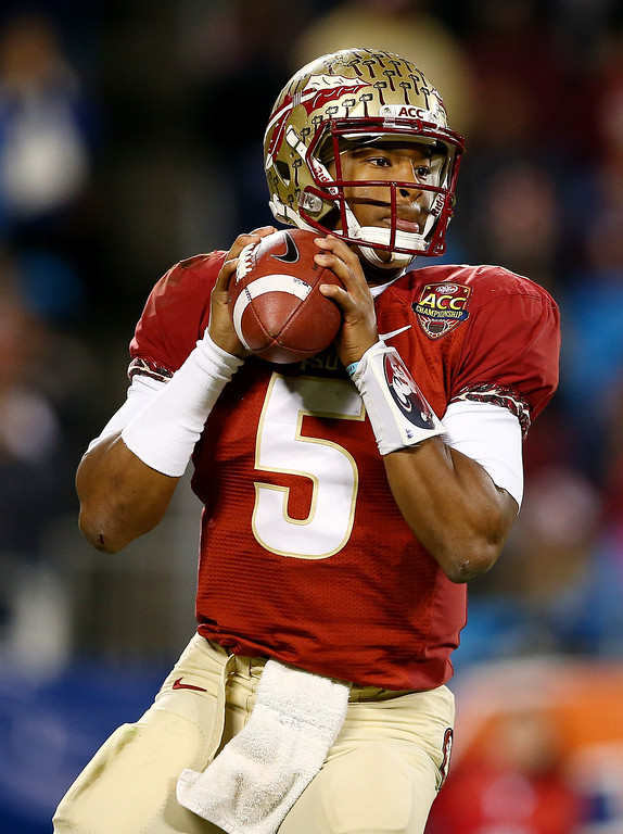 . Quarterback Jameis Winston #5 of the Florida State Seminoles passes against the Duke Blue Devils during the ACC Championship game at Bank of America Stadium on December 7, 2013 in Charlotte, North Carolina.  (Photo by Streeter Lecka/Getty Images)