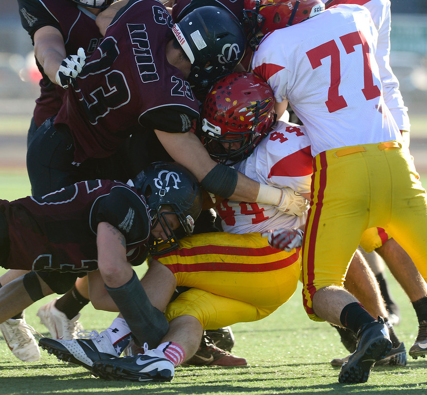 . Coronado\'s Zeb Foster runs into Silver Creek\'s Jeremy Metivier (23) and Jared Jacobson (35) in the third quarter of the Class 3A state championship game Saturday Nov. 30, 2013 at Everly-Montgomery Field.  (Lewis Geyer/Times-Call)