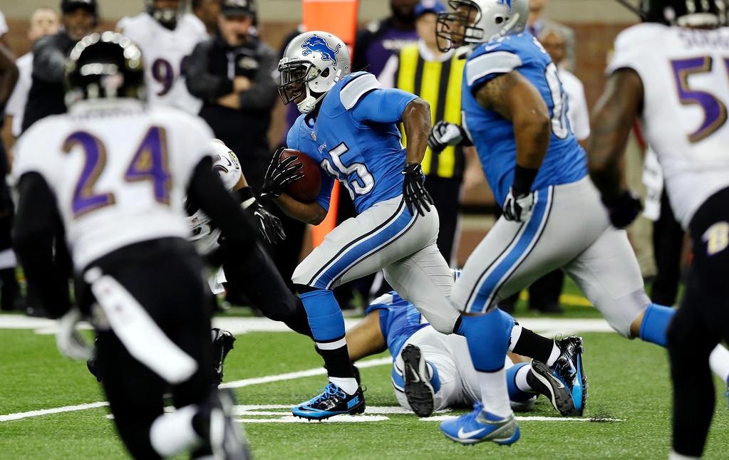 . Detroit Lions running back Joique Bell (35) breaks through the Baltimore Ravens defense during the first quarter of an NFL football game in Detroit, Monday, Dec. 16, 2013. (AP Photo/Carlos Osorio)