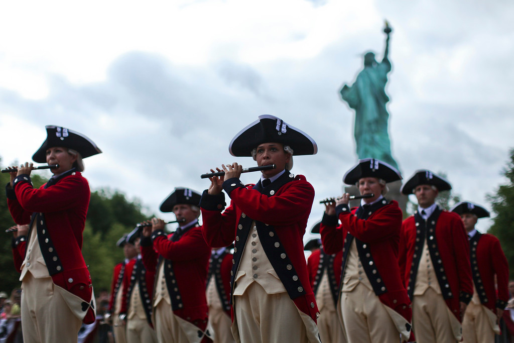 . The 3d U.S. Infantry, traditionally known as \'The Old Guard\', perform during a ceremony to reopen the Statue of Liberty and Liberty Island to the public in New York July 4, 2013. Under steamy summer skies, tourists in New York flocked to ferries headed for the Statue of Liberty, re-opening with an Independence Day ceremony after closing in October as Superstorm Sandy approached. REUTERS/Eduardo Munoz