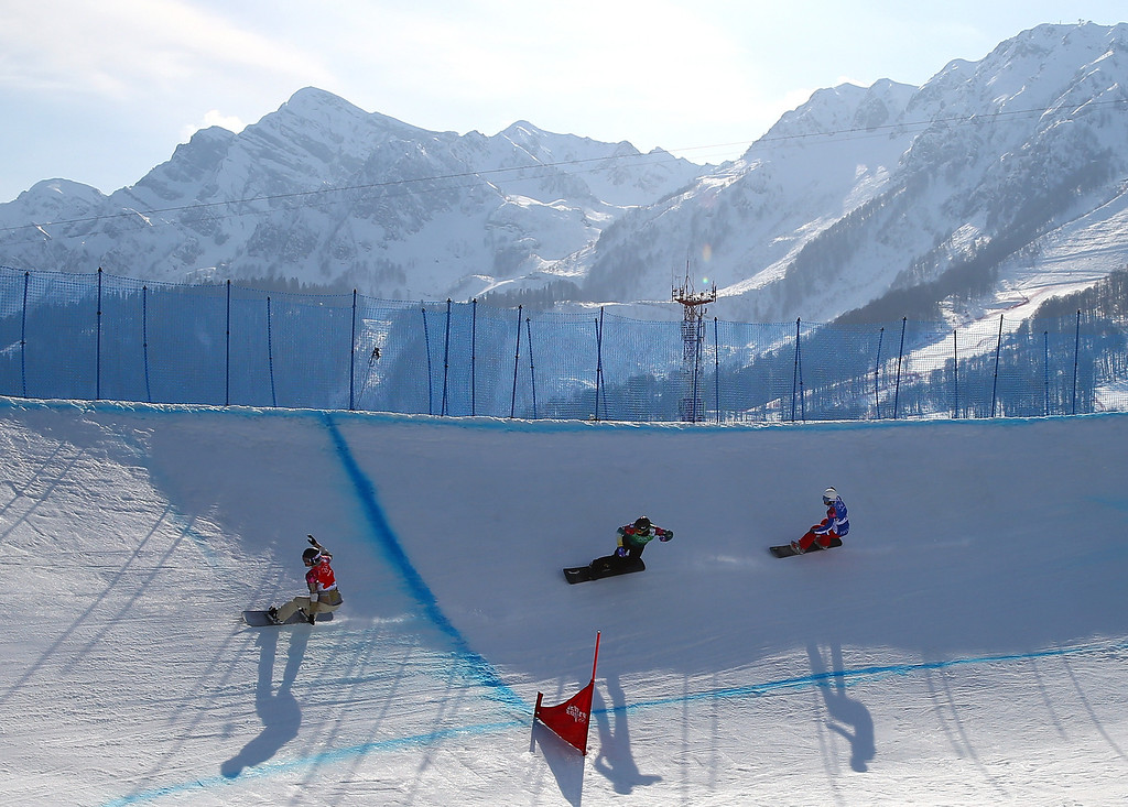 . Riders compete during the Ladies\' Snowboard Cross Final on day nine of the Sochi 2014 Winter Olympics at Rosa Khutor Extreme Park on February 16, 2014 in Sochi, Russia.  (Photo by Streeter Lecka/Getty Images)