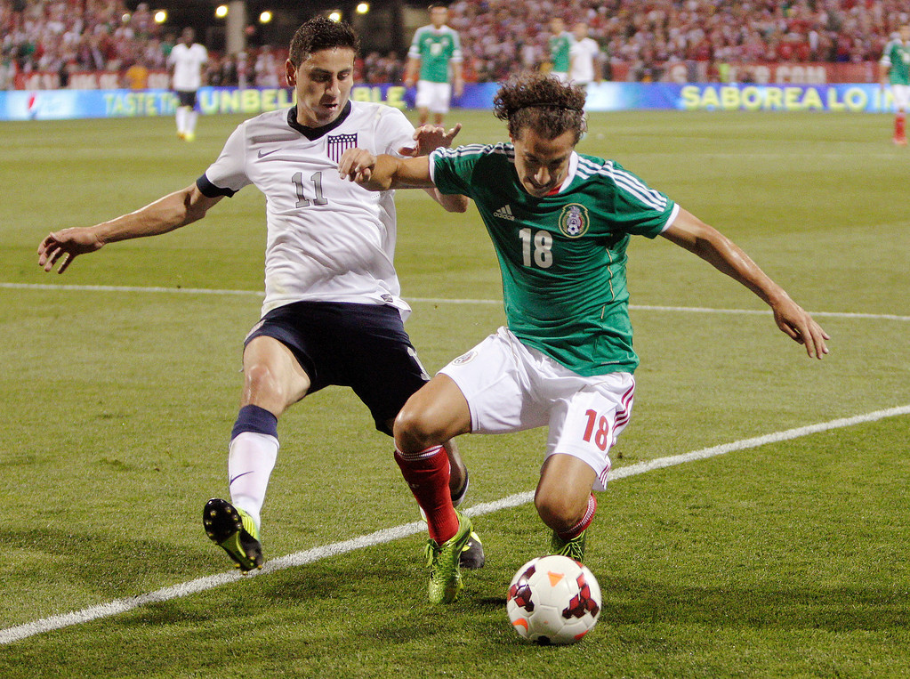 . The United States\' Alejandro Bedoya, left, and Mexico\'s Andr�s Guardado chase a loose ball during the first half of a World Cup qualifying soccer match Tuesday, Sept. 10, 2013, in Columbus, Ohio. (AP Photo/Jay LaPrete)