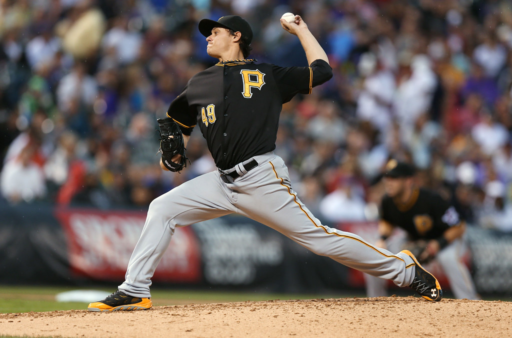 . Pittsburgh Pirates starting pitcher Jeff Locke throws to a Colorado Rockies batter in the fourth inning of a baseball game in Denver on Saturday, July 26, 2014. (AP Photo/David Zalubowski)