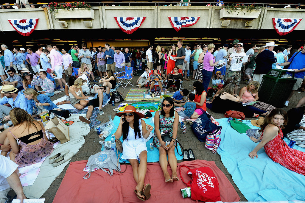 . ELMONT, NY - JUNE 07:  Race fans are seen prior to the Belmont Stakes at Belmont Park on June 7, 2014 in Elmont, New York.  (Photo by Drew Hallowell/Getty Images)