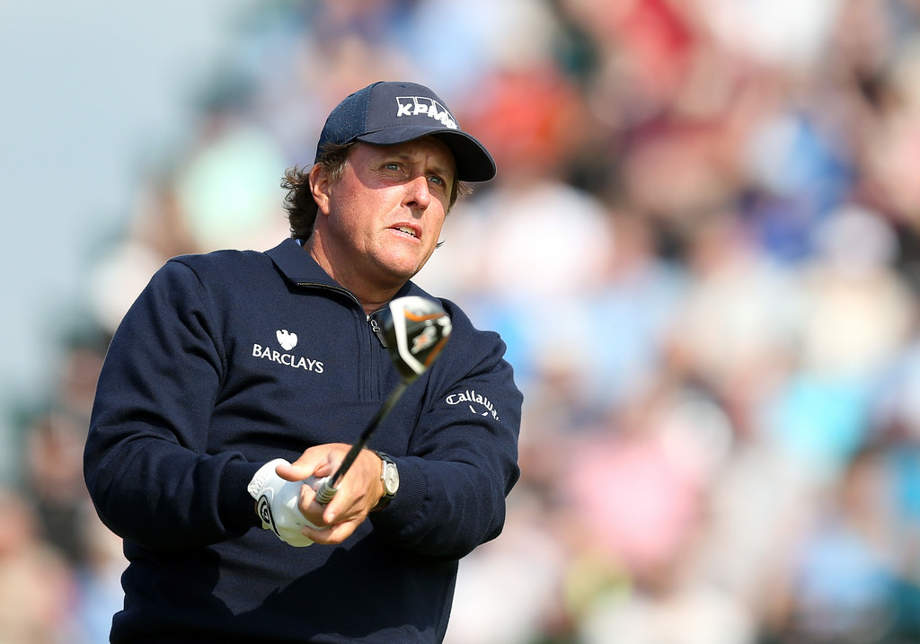 . Phil Mickelson of the US watches his shot off the 3rd tee during the second day of the British Open Golf championship at the Royal Liverpool golf club, Hoylake, England, Friday July 18, 2014. (AP Photo/Scott Heppell)