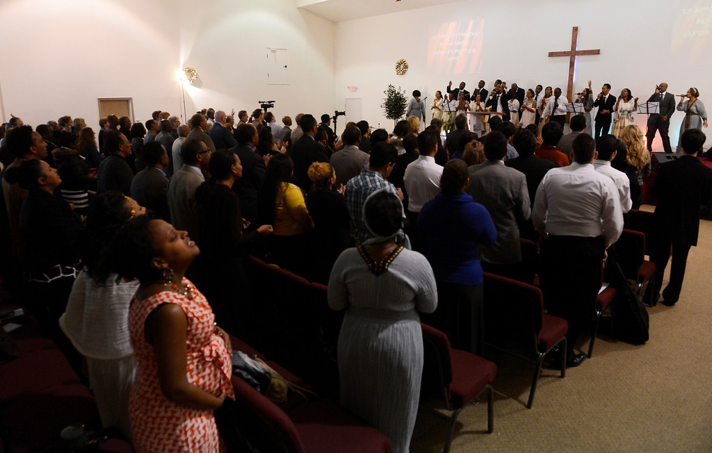 . AURORA, CO. - JANUARY 11:  The Addis Kidan Evangelical Church choir gets the crowd on their feet during the church dedication service, Saturday morning, January 10, 2014. (Photo By Andy Cross / The Denver Post)