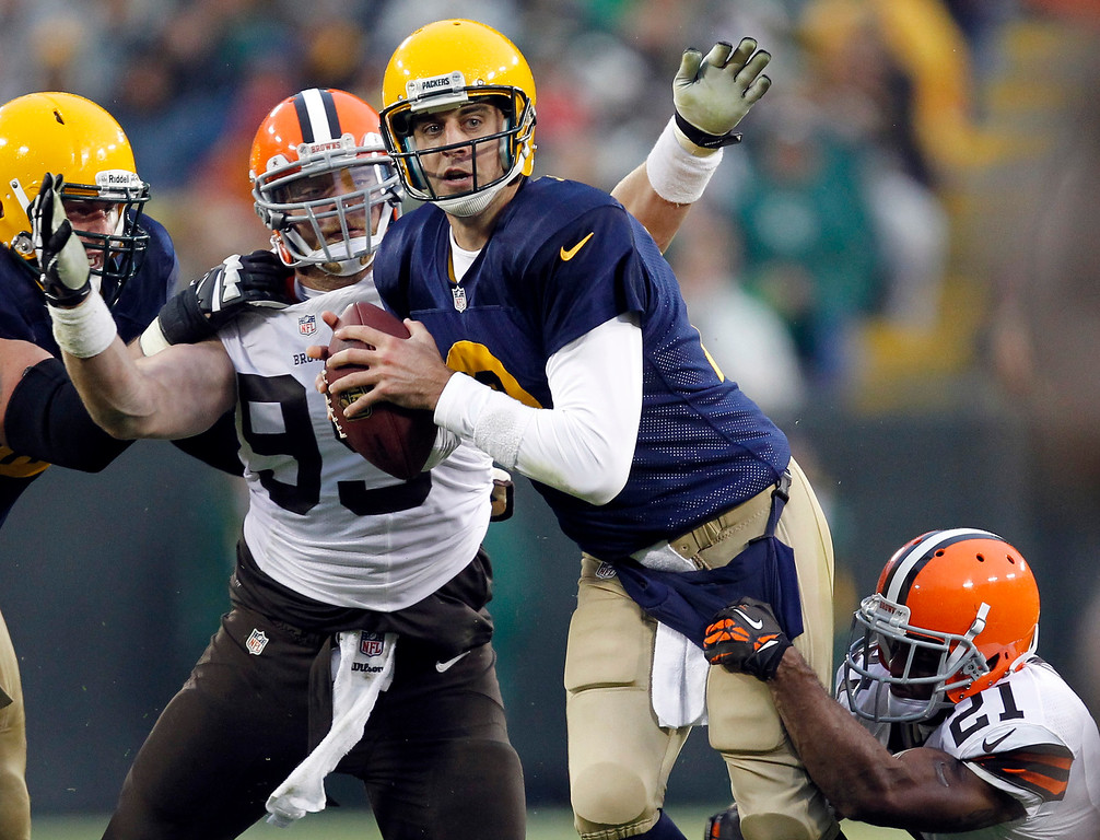 . Green Bay Packers quarterback Aaron Rodgers is sacked by Cleveland Browns\' Chris Owens (21) and Paul Kruger during the second half of an NFL football game Sunday, Oct. 20, 2013, in Green Bay, Wis. (AP Photo/Mike Roemer)