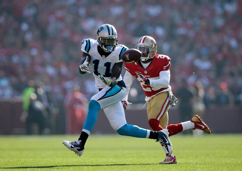 . Brandon LaFell #11 of the Carolina Panthers catches the ball while covered by Tarell Brown #25 of the San Francisco 49ers at Candlestick Park on November 10, 2013 in San Francisco, California.  (Photo by Ezra Shaw/Getty Images)