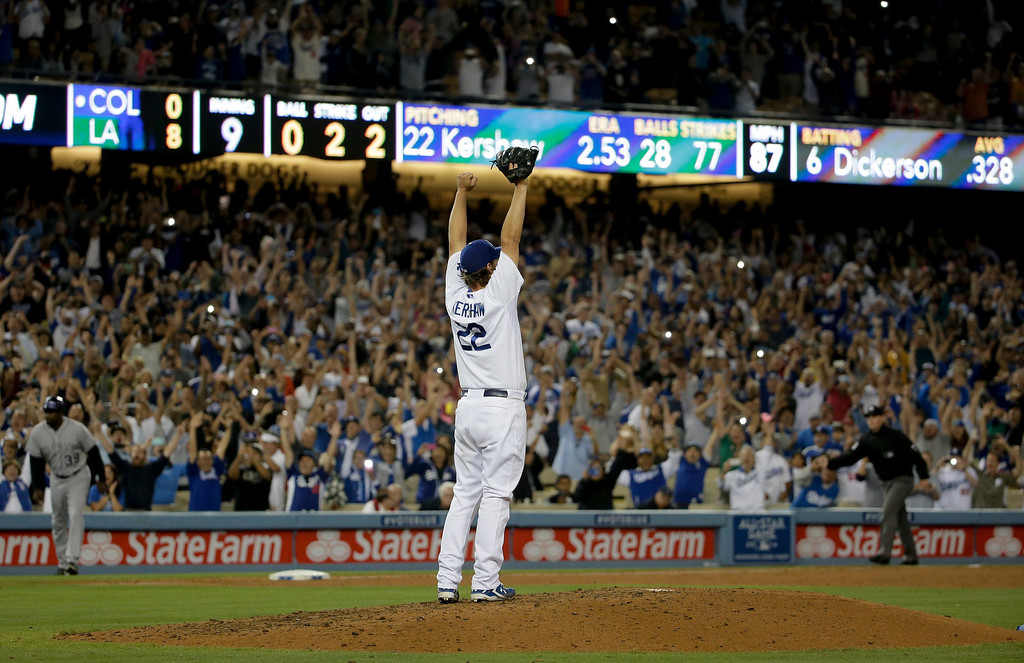 . Los Angeles Dodgers starting pitcher Clayton Kershaw celebrates his no-hitter against the Colorado Rockies after the last out of a baseball game in Los Angeles, Wednesday, June 18, 2014. Kershaw struck out a career-high 15 batters. (AP Photo/Chris Carlson)