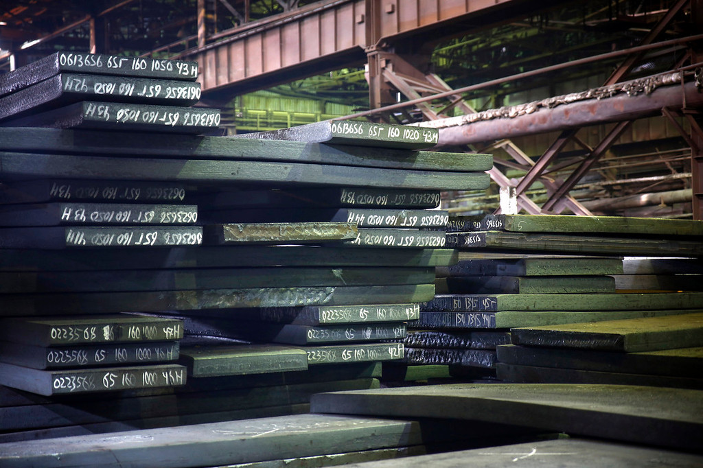 . Steel plates marked and coded sit stacked inside the Zaporizhstal steel plant, owned and operated by Metinvest BV at their site in Zaporizhzhya, Ukraine, on Tuesday, Oct. 15, 2013. Metinvest BV, Ukraine\'s largest steelmaker, last year acquired 49.9% in steelmaker Zaporizhstal a manufacturer of semi-finished steel products, including hot and cold-rolled plates and coils. Photographer: Vincent Mundy/Bloomberg