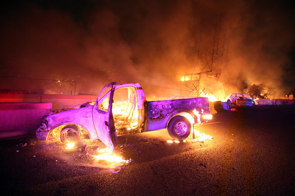 . Burned cars are pictured in a highway in Ecatepec near Mexico city, on May 7, 2013. A gas tanker exploded in a Mexico City suburb on Tuesday, killing at least 18 people and damaging several homes and cars, an official said. VICTOR ROJAS/AFP/Getty Images