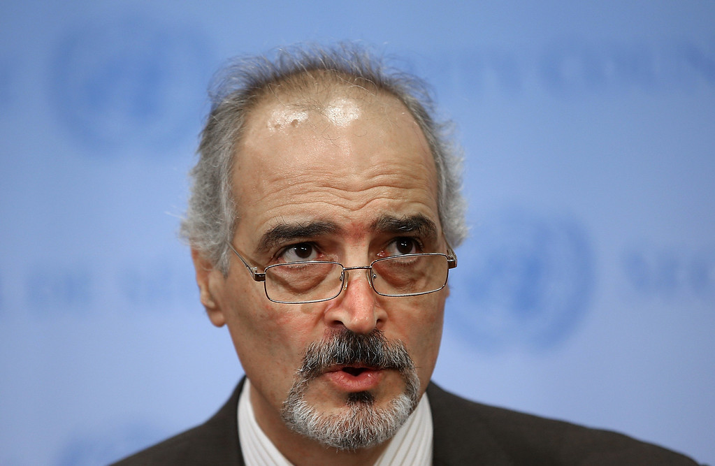 . NEW YORK, NY - AUGUST 28:  Syrian Ambassador to the United Nations Bashar Ja\'afari speaks to reporters outside the Security Council following the introduction of a draft resolution calling for U.N. authority to protect Syrian civilians on August 28, 2013 in New York City. The United Kingdom introduced the proposed resolution following a suspected chemical weapons attack in Syria by the Assad regime.  (Photo by Mario Tama/Getty Images)