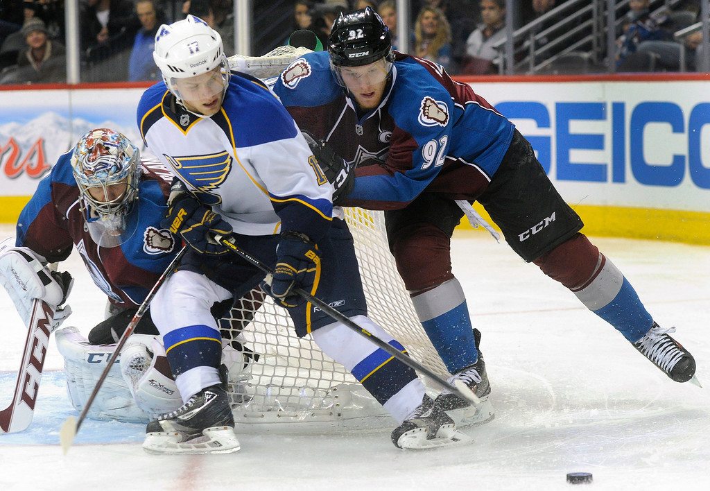 . Colorado wing Gabriel Landeskog (92) pushed St. Louis wing Vladimir Sobotka (17) off the puck in front of Avs goaltender Semyon Varlamov in the second period. The St. Louis Blues beat the Colorado Avalanche 4-1 at the Pepsi Center Wednesday night, November 27, 2013.   Photo By Karl Gehring/The Denver Post