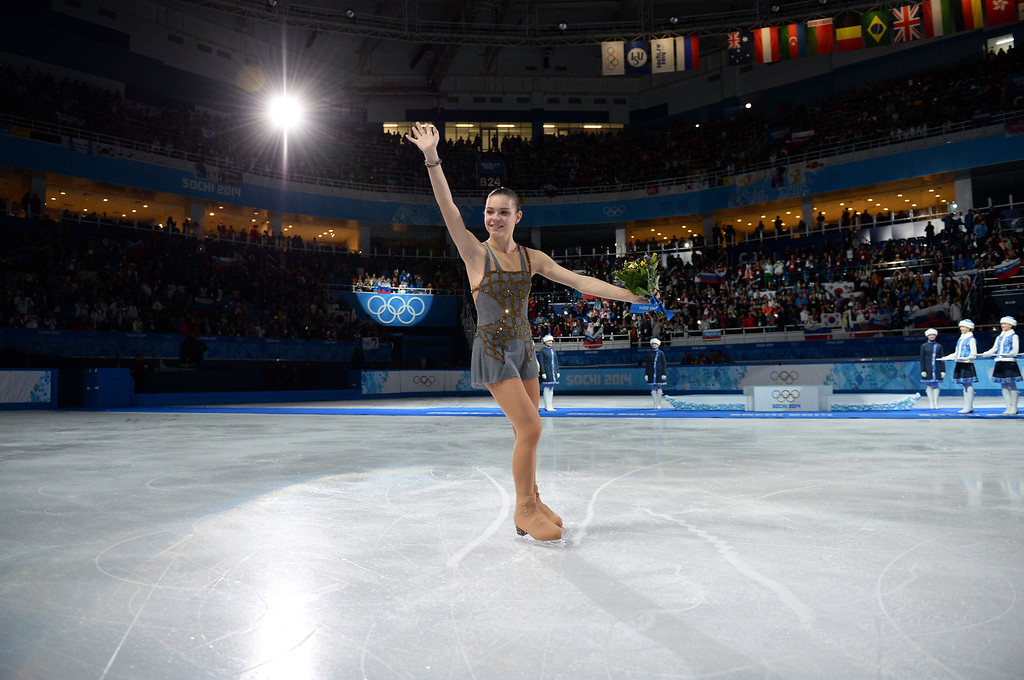 . Russia\'s gold medalist Adelina Sotnikova celebrates during the Women\'s Figure Skating Flower Ceremony at the Iceberg Skating Palace during the Sochi Winter Olympics on February 20, 2014.  YURI KADOBNOV/AFP/Getty Images
