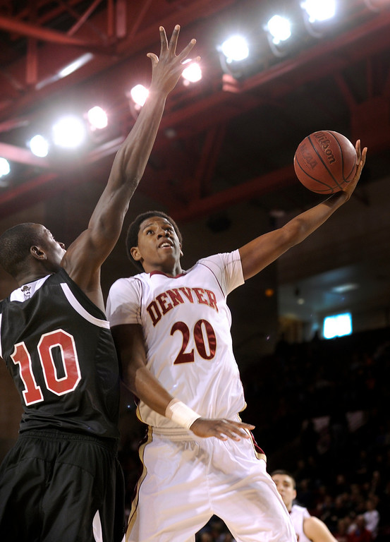 . DENVER, CO. - MARCH 2: Denver forward Royce O\'Neale (2) tried to get a shot past Aggies defender Bandja Sy (10) in the first half. The University of Denver men\'s basketball team defeated New Mexico State 66-60 Saturday evening, March 2, 2013 at Magness Arena. (Photo By Karl Gehring/The Denver Post)