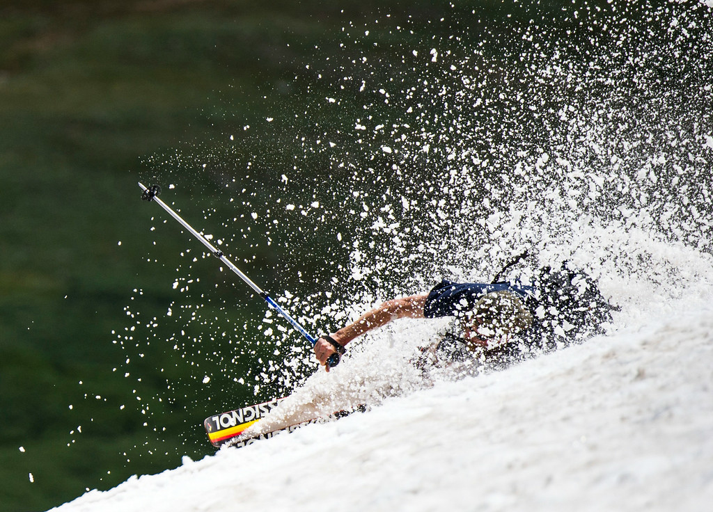 . A man, who only gave his name as Trey wipes out during the 49th running of the Epworth Cup, an unofficial ski race atop Corona Pass on Sunday, July 13, 2014 in Winter Park, CO.  The summer ski race, which was originally founded in 1966 is a memorial to a Winter Park patroller that died on Mt Epworth.  (Photo by Kent Nishimura/The Denver Post)