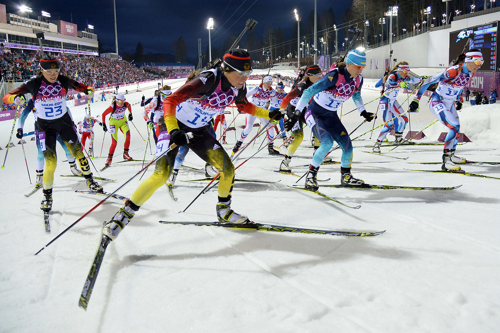 . Germany\'s Evi Sachenbacher-Stehle (23) and Germany\'s Andrea Henkel (14) compete in the Women\'s Biathlon 12,5 km Mass Start at the Laura Cross-Country Ski and Biathlon Center during the Sochi Winter Olympics on February 17, 2014, in Rosa Kuthor, near Sochi.  AFP PHOTO / ALBERTO  PIZZOLI/AFP/Getty Images