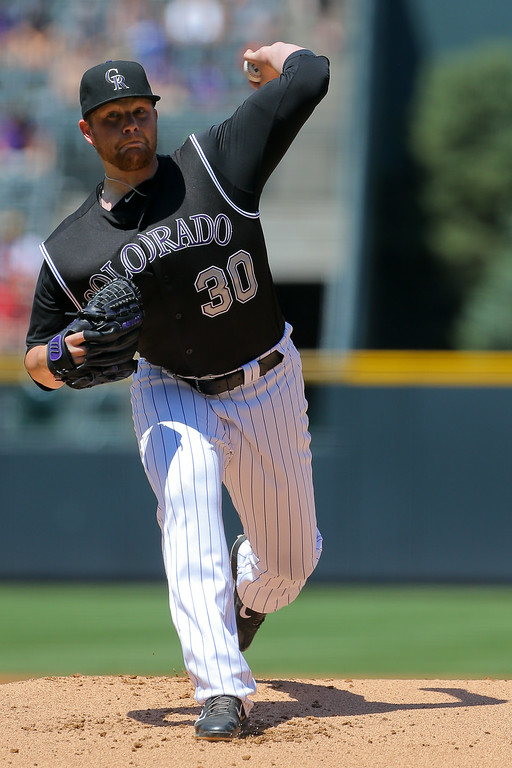 . Starting pitcher Brett Anderson #30 of the Colorado Rockies delivers to home plate during the first inning against the Minnesota Twins at Coors Field on July 13, 2014 in Denver, Colorado. (Photo by Justin Edmonds/Getty Images)