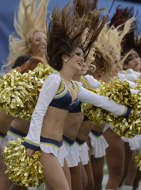 . The San Diego Chargers cheerleaders dance during a timeout during the game against the New York Giants on December 8, 2013 at Qualcomm Stadium in San Diego, California. (Photo by Donald Miralle/Getty Images)