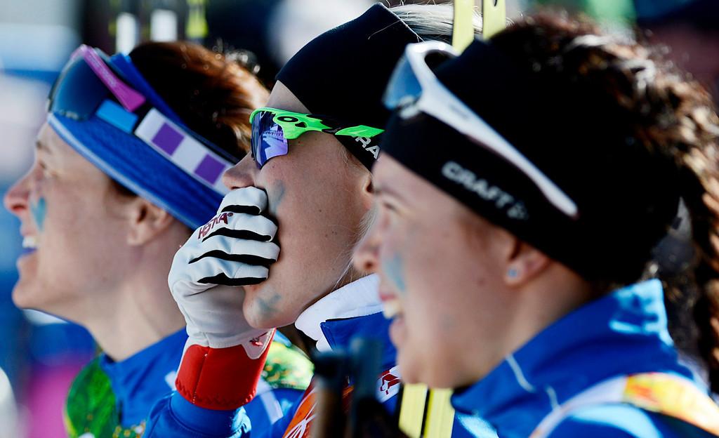 . Anne Kylloenen (C) Aino-Kaisa Saarinen (L) and Kerttu Niskanen of Finland react in finish line during the Women\'s 4 x 5km Relay competition at the Laura Cross Country Center during the Sochi 2014 Olympic Games, Krasnaya Polyana, Russia, 15 February 2014.  EPA/FILIP SINGER