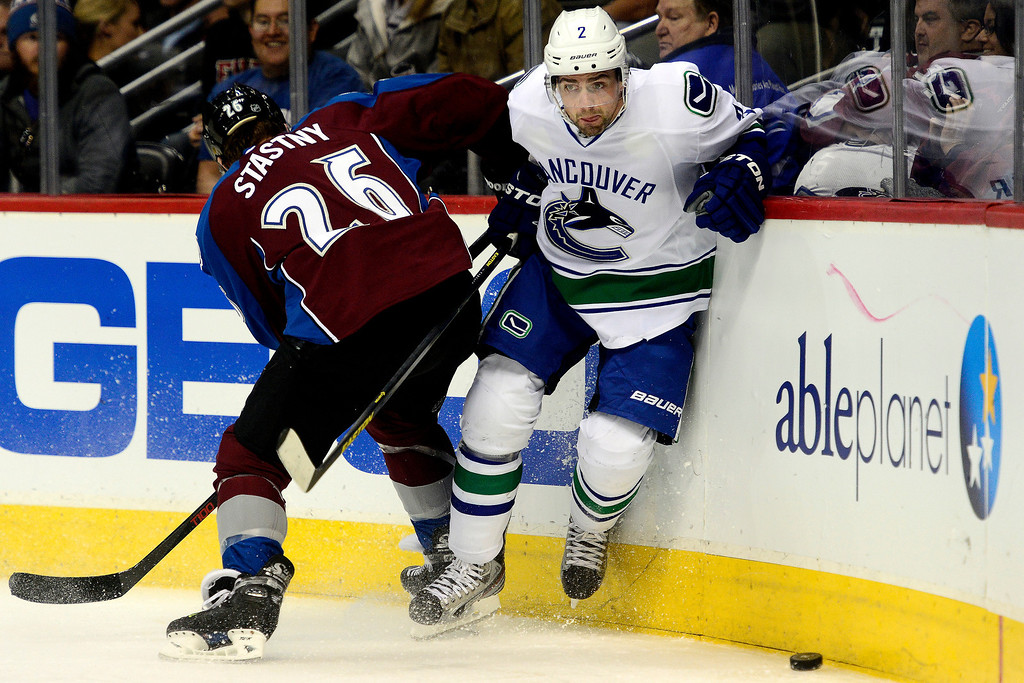. DENVER, CO - MARCH 24: Dan Hamhuis (2) of the Vancouver Canucks skates as Paul Stastny (26) of the Colorado Avalanche defends during the first period of action. Colorado Avalanche versus the Vancouver Canucks at the Pepsi Center. (Photo by AAron Ontiveroz/The Denver Post)