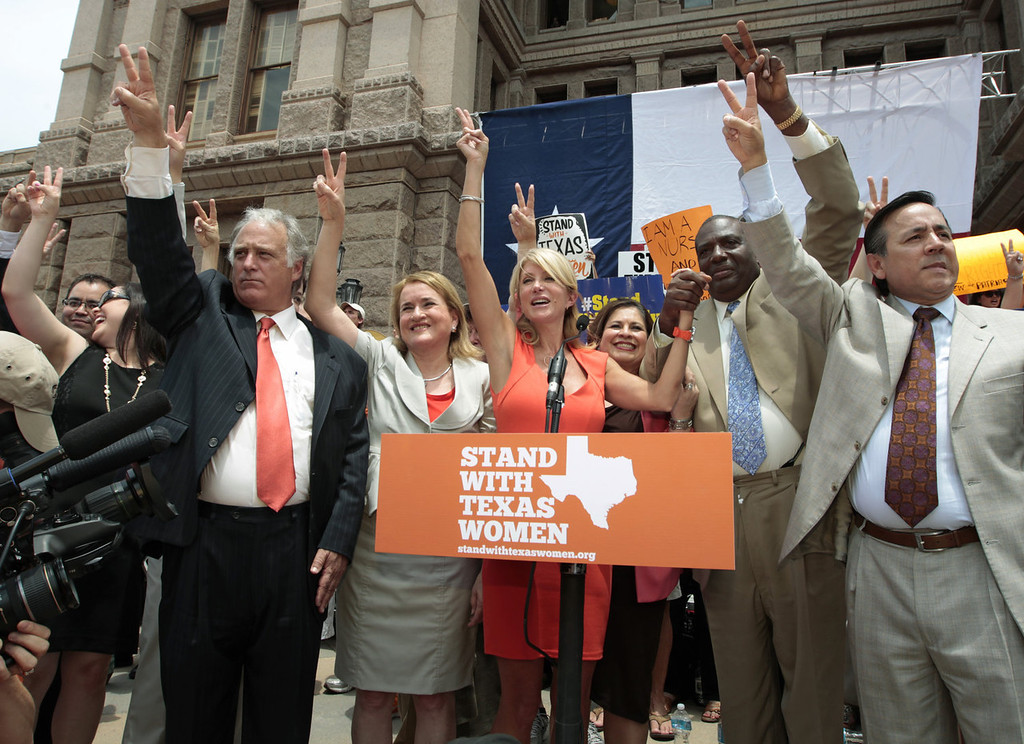 . Texas Sen. Wendy Davis (D-Ft. Worth) is surrounded by supporting Texas representatives and senators after leading a rally in support of Texas women\'s right to reproductive decisions at the Texas state capitol on July 1, 2013 in Austin, Texas. This is the first day of a second legislative special session called by Texas Gov. Rick Perry to pass a restrictive abortion law through the Texas legislature. The first attempt was defeated after opponents of the law were able to stall the vote until after first special session had ended.  (Photo by Erich Schlegel/Getty Images)