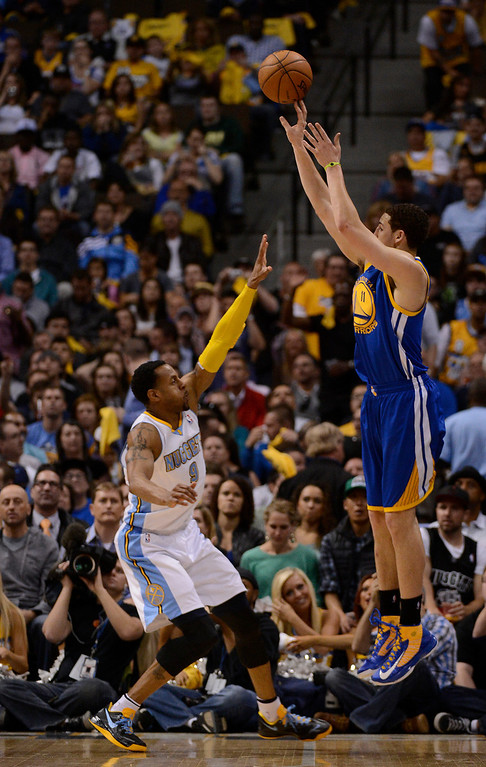 . Golden State Warriors shooting guard Klay Thompson (11) puts up a shot over Denver Nuggets shooting guard Andre Iguodala (9) in the second quarter. The Denver Nuggets took on the Golden State Warriors in Game 5 of the Western Conference First Round Series at the Pepsi Center in Denver, Colo. on April 30, 2013. (Photo by John Leyba/The Denver Post)