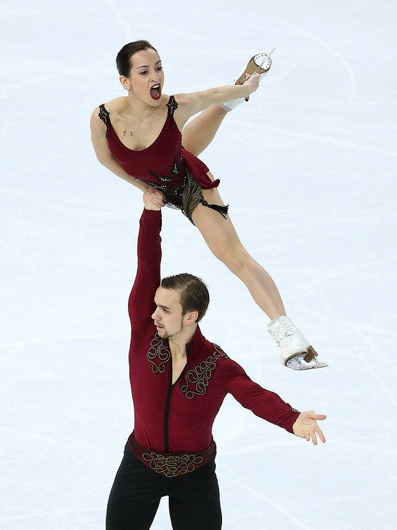 Description of . Ksenia Stolbova and Fedor Klimov of Russia compete during the Figure Skating Pairs Short Program on day four of the Sochi 2014 Winter Olympics at Iceberg Skating Palace on February 11, 2014 in Sochi, Russia.  (Photo by Matthew Stockman/Getty Images)
