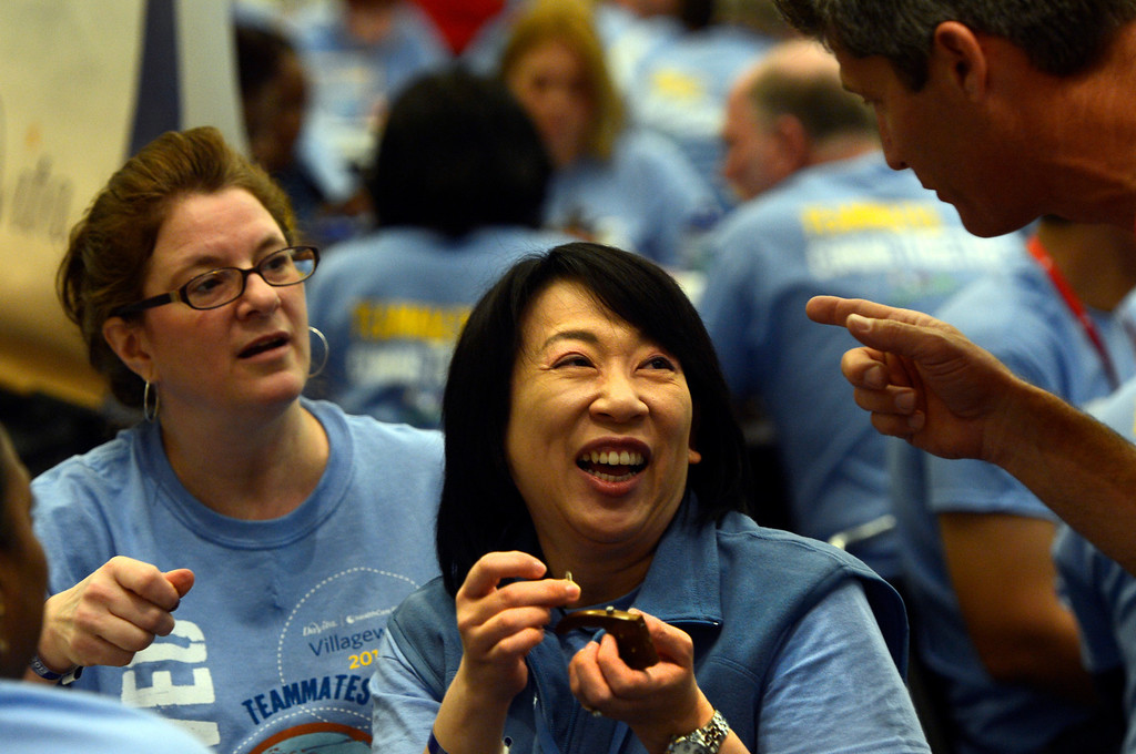 . DENVER, CO. - APRIL 27: Donna Fahrbach and Ling Chang get advice while assembling a prosthetic hand at the Colorado Convention Center in Denver, CO April 27, 2013. Over 4,000 volunteers from DaVita HealthCare Partners took part in the Odyssey Teams �Helping Hands� program, assembling 1,400 prosthetic hands. LN-4 created, and will distribute the prosthetic hands to amputees in over 60 developing countries. (Photo By Craig F. Walker/The Denver Post)