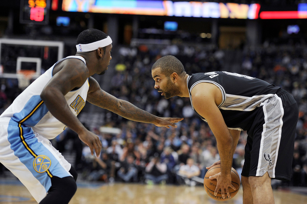 . Tony Parker #9 of the San Antonio Spurs looks to get around Ty Lawson #3 of the Denver Nuggets during the second quarter of an NBA game at the Pepsi Center on November 5, 2013, in Denver, Colorado. (Photo by Daniel Petty/The Denver Post)