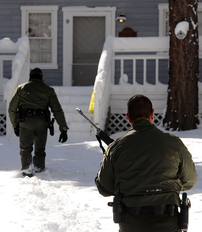 . (Will Lester/Staff Photographer)  San Bernardino County Sheriff deputies continue to search door-to-door along Willow Avenue in Big Bear for ex-LAPD fugitive Christopher Jordan Dorner Saturday February 9, 2013. Search conditions improved Saturday as skies cleared in the area after a heavy winter storm dropped over a foot of snow in the mountain community Friday.