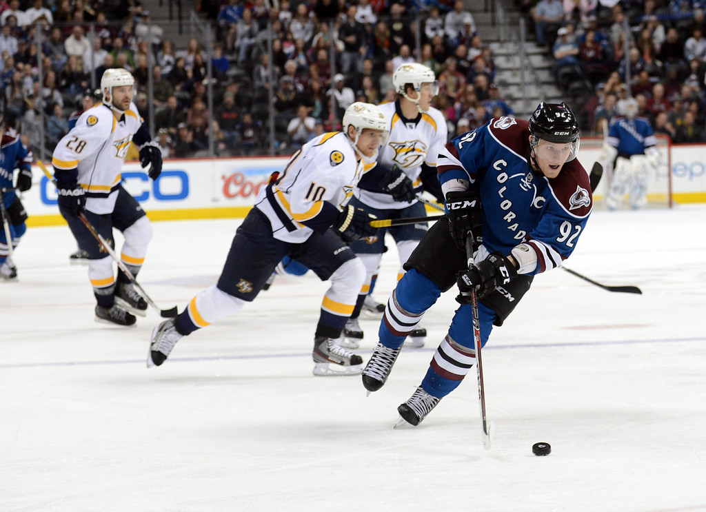 . Gabriel Landeskog of Colorado Avalanche (#92) controls the pack in the 3rd period of the game against Nashville Predators at Pepsi Center. Denver, Colorado. March 30, 2013. Colorado won 1-0 in OT. (Photo By Hyoung Chang/The Denver Post)