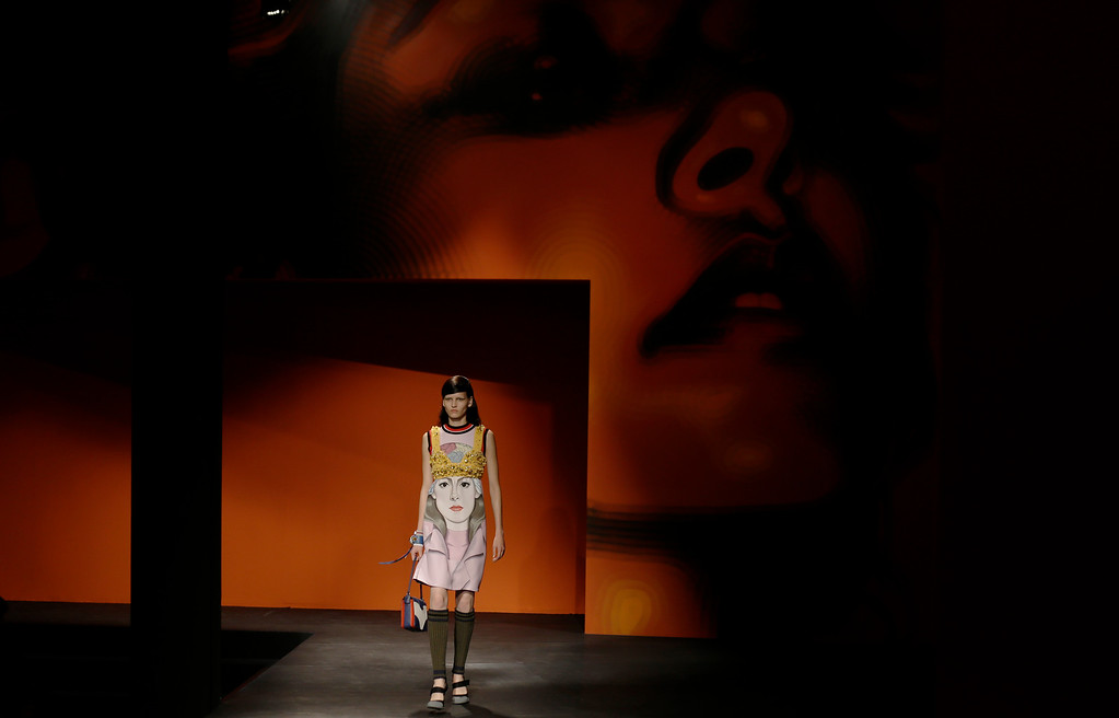 . A model wears a creation for Prada\'s women\'s Spring-Summer 2014 collection, part of the Milan Fashion Week, unveiled in Milan, Italy, Thursday, Sept. 19, 2013. (AP Photo/Luca Bruno)