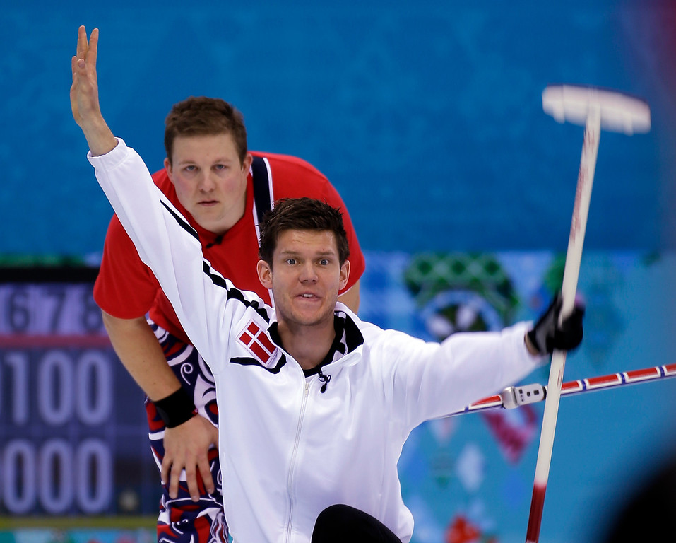 . Denmark\'s Rasmus St Jerne Hansen reacts to his shot as Norway\'s Christoffer Svae watches  during a round robin match at the 2014 Winter Olympics, Monday, Feb. 17, 2014, in Sochi, Russia. (AP Photo/Morry Gash)