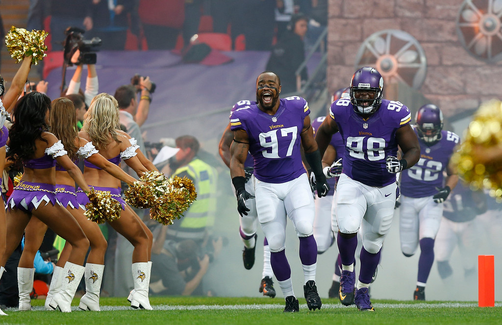 . Minnesota Vikings defensive end Everson Griffen, left, and fellow defensive end Brian Robison react as they take to the field ahead of the NFL football game against Minnesota Vikings\' at Wembley Stadium, London, Sunday, Sept. 29, 2013.  (AP Photo/Sang Tan)