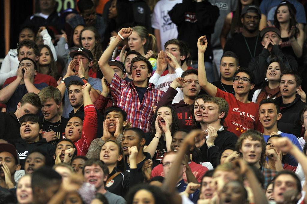 . DENVER, CO. - MARCH 08: East High School students cheer the team during 5A state quarter final boys basketball game against Arapahoe High School at Denver Coliseum. East won 60-55. March 8, 2013. Denver, Colorado. (Photo By Hyoung Chang/The Denver Post)
