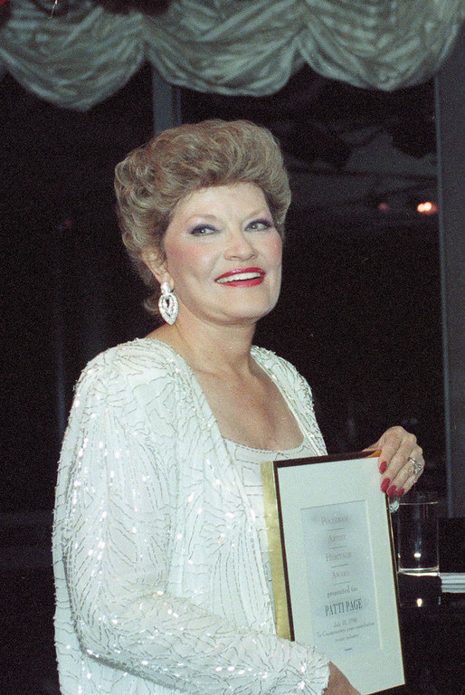 . Singer Patti Page poses with the first Heritage Artist Award presented to her by Polygram records at the Rainbow Room in New York City, July 11, 1990. (AP Photo/Susan Ragan)
