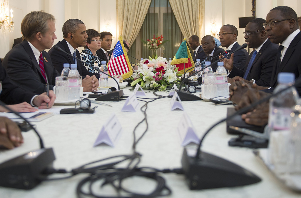 . US President Barack Obama (2nd L) and his delegtion faces Senegal President Macky Sall (2nd R) and his delegation on June 27, 2013 during a bilateral meeting at the presidential palace in Dakar. Obama arrived late on June 26 in Dakar to launch a three-nation trip designed to fulfil neglected expectations for his presidency on a continent where he has deep ancestral roots. JIM WATSON/AFP/Getty Images
