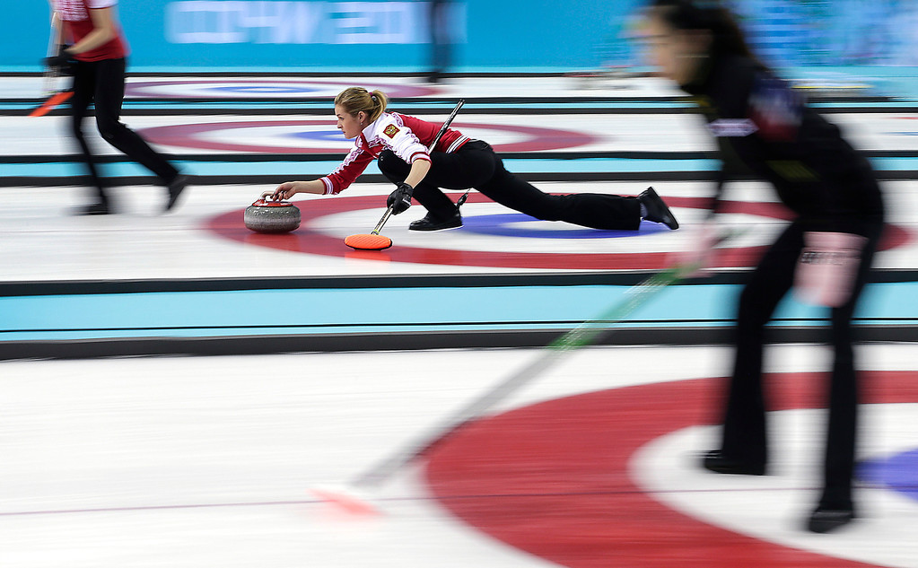 . Russia\'s Margarita Fomina delivers the rock during the women\'s curling competition against the United States at the 2014 Winter Olympics, Tuesday, Feb. 11, 2014, in Sochi, Russia. (AP Photo/Wong Maye-E)