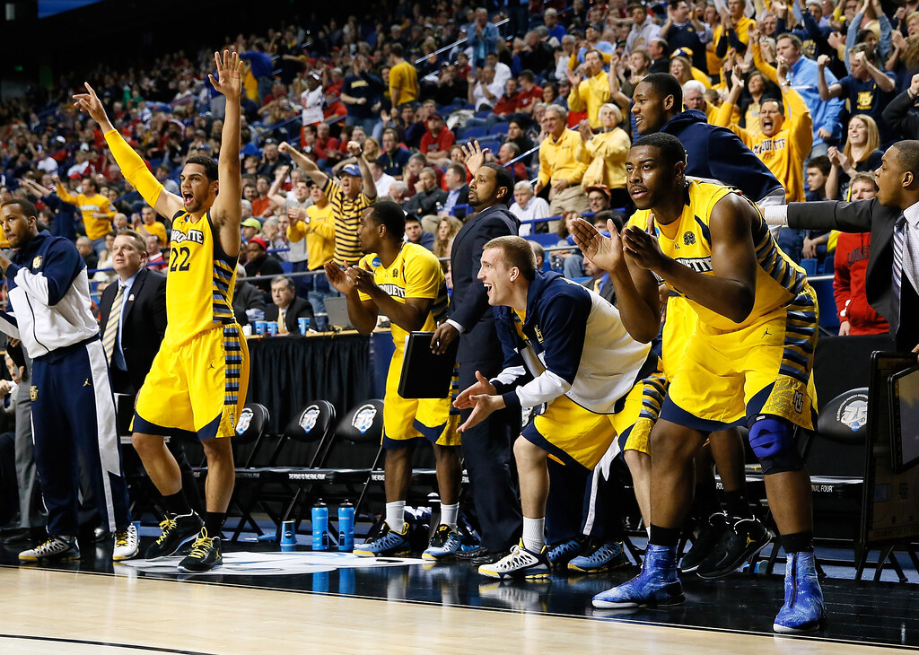. LEXINGTON, KY - MARCH 23: The Marquette Golden Eagles bench celebrates after a steal and a basket against the Butler Bulldogs in the second half during the third round of the 2013 NCAA Men\'s Basketball Tournament at Rupp Arena on March 23, 2013 in Lexington, Kentucky.  (Photo by Kevin C. Cox/Getty Images)