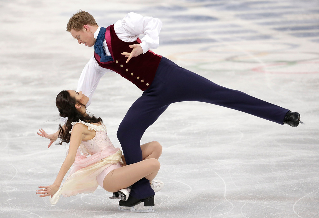 . Madison Chock and Evan Bates of the United States compete in the ice dance free dance figure skating finals at the Iceberg Skating Palace during the 2014 Winter Olympics, Monday, Feb. 17, 2014, in Sochi, Russia. (AP Photo/Bernat Armangue)