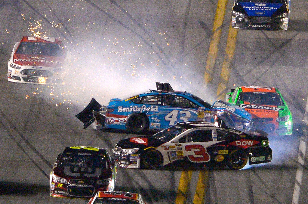 . Aric Almirola (43), Austin Dillon (3) and Danica Patrick (10) collide on the front stretch during the NASCAR Daytona 500 auto race at Daytona International Speedway in Daytona Beach, Fla., Sunday, Feb. 23, 2014. (AP Photo/Phelan M. Ebenhack)